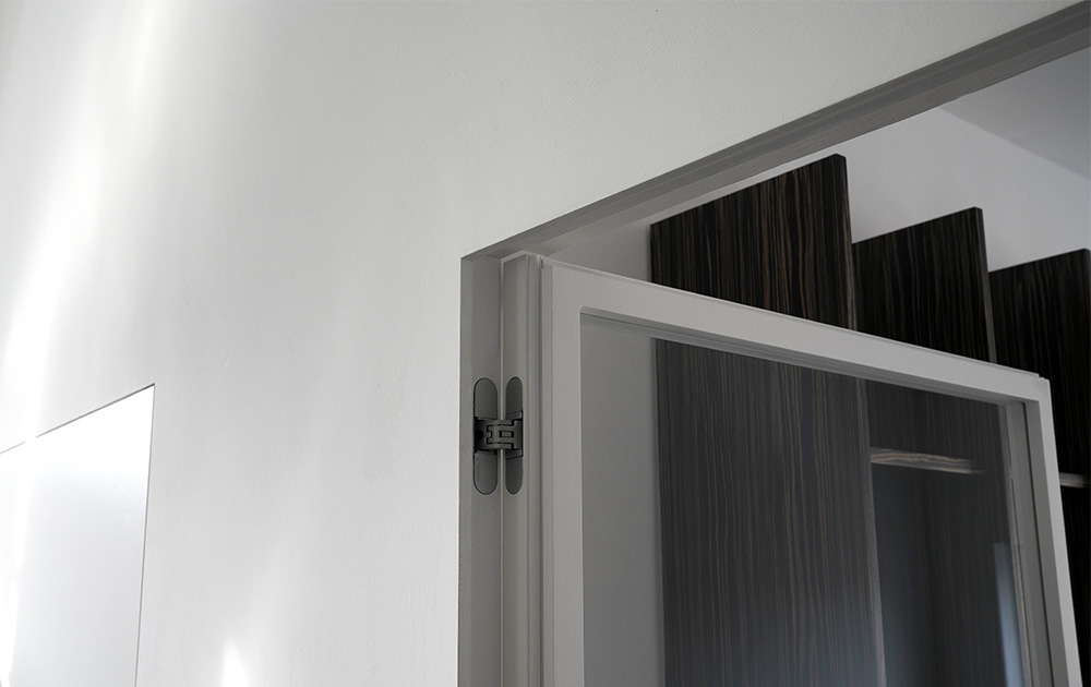 Porta filomuro battente a vetro - Evoline3